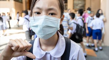 Asian girl student wearing medical face mask in school, epidemic, spread of germ, Coronavirus
