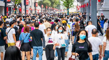Crowd of Chinese people wearing surgical face mask