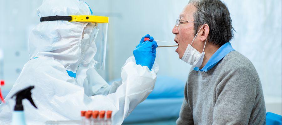 Coronavirus test - Medical worker taking a throat swab for coronavirus sample