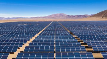 Aerial view of hundreds solar energy modules or panels